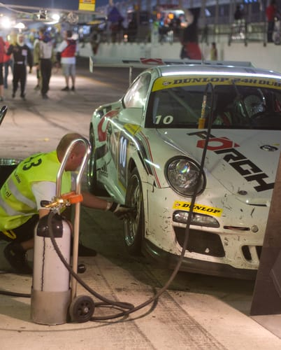 pit stop at night for car 10, a porsche 997 GT3 cup during the 2012 dunlop 24 hour race at dubai autodrome-img-blog