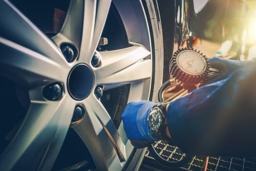 car tire pressure check in the auto service garage-img-blog