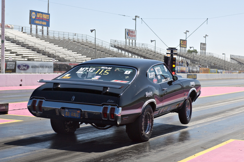 hot rod car pops a wheelie at the start of the race at the nhra pacific division drag racing-img-blog championship