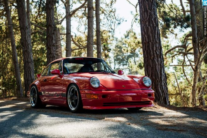 A 1989 Porsche 964 sits in a treeline near 911 Design in Southern California.
