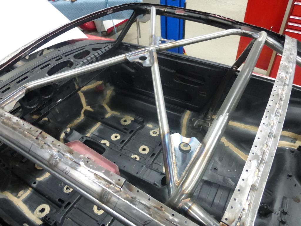 The interior of a 1993 Porsche® 964 with stitch welds.